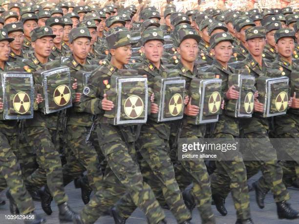 Soldiers march during the military parade for the 70th anniversary of the founding of the ruling workers' party on Kim Il-Sung Square in Pyongyang,...
