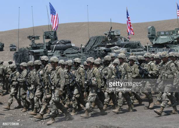US soldiers march during the official closing ceremony of the multinational military exercise 'Noble Partner 2017' at the military base of Vaziani...