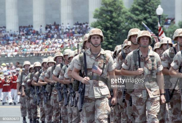 Soldiers march in the victory parade honoring those who served in Operation Desert Storm