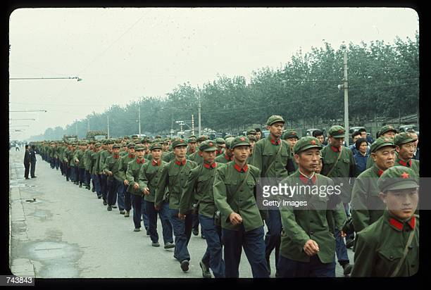 Soldiers march in Tiananmen Square September 18 1976 to honor Chinese Leader Mao Zedong's death in Peking China Zedong died September 9 1976 from...