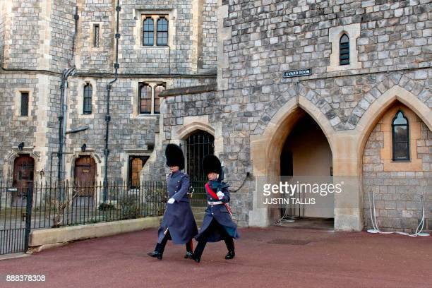 Soldiers march inside the grounds of Windsor Castle in Windsor west of London on December 8 2017 Britain's Prince Harry will marry his US actress...