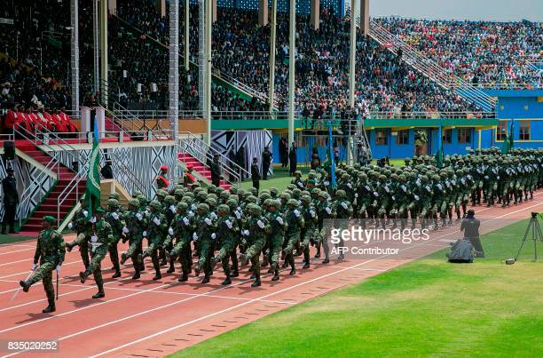 Soldiers march past Rwanda's President Paul Kagame during his swearingin for third term as president on August 18 2017 in Kigali Rwandan President...