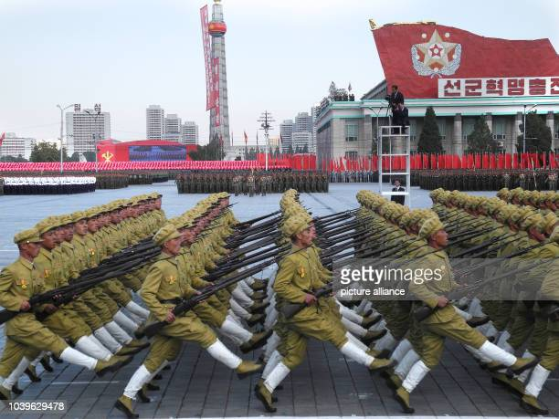 Soldiers march with bayonets during the military parade for the 70th anniversary of the founding of the ruling workers' party on Kim Il-Sung Square...