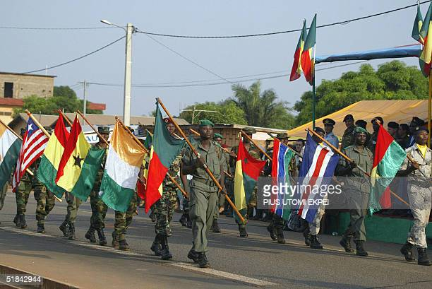 ECOWAS soldiers march with flags of member countries participating in the closing ceremony of the joint military exercise at Abomey in Benin 09...
