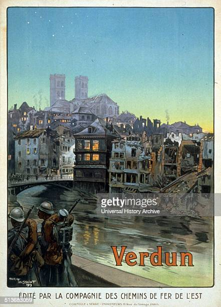 Soldiers marching beside a river and over a bridge into a shelled Verdun The battle of Verdun in 1916 was the longest and costliest battle in terms...