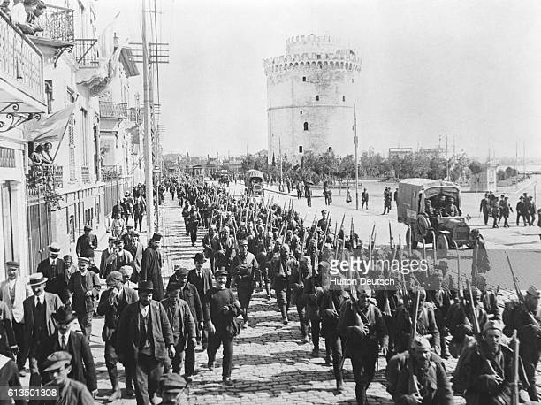 Soldiers marching down Boulevard de la Victoire in Salonika on the Balkan Front during the First World War Austria Germany and Bulgaria invaded...