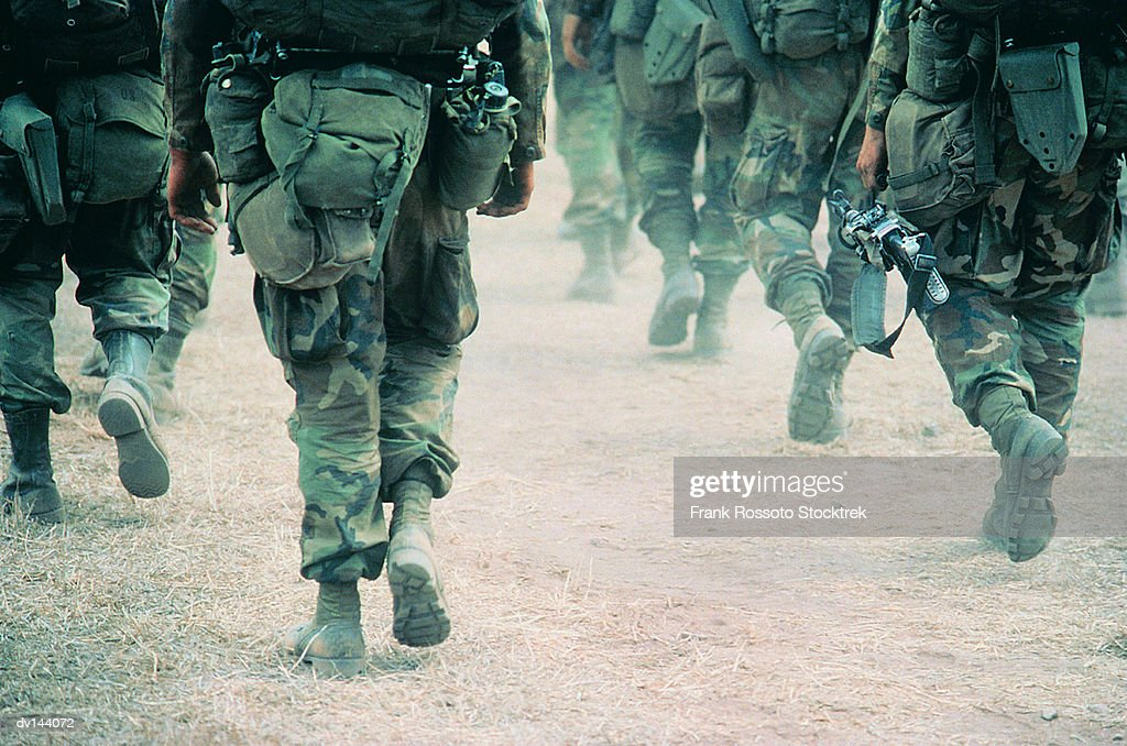 Soldiers marching in desert : Stock Photo