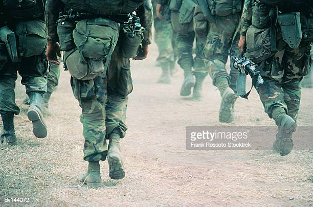 soldiers marching in desert - army soldier stock photos and pictures