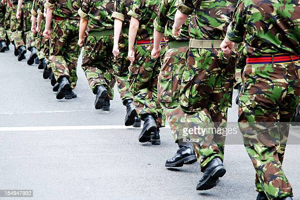 soldiers marching in line - britain stock pictures, royalty-free photos & images