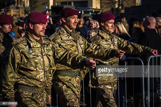 CONTENT] Soldiers marching into the morning light at the Service of Remembrance at The Cenotaph St George's Hall Liverpool