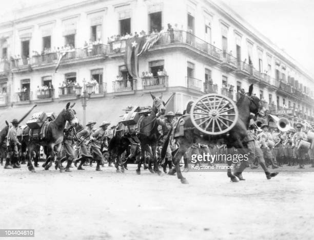 Soldiers marching with their guns during the celebrations of the 33rd anniversary of Cuban independence Cuba was under United States protectorate...
