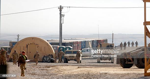 Soldiers move near the headquarters of the 133rd Engineer Battalion of the Maine Army National Guard Friday December 20 at Bagram Airfield in...