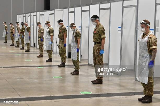 Soldiers observe a 2 minute silence for Armistice day in remembrance of the nations war dead on November 11, 2020 at a coronavirus rapid testing...