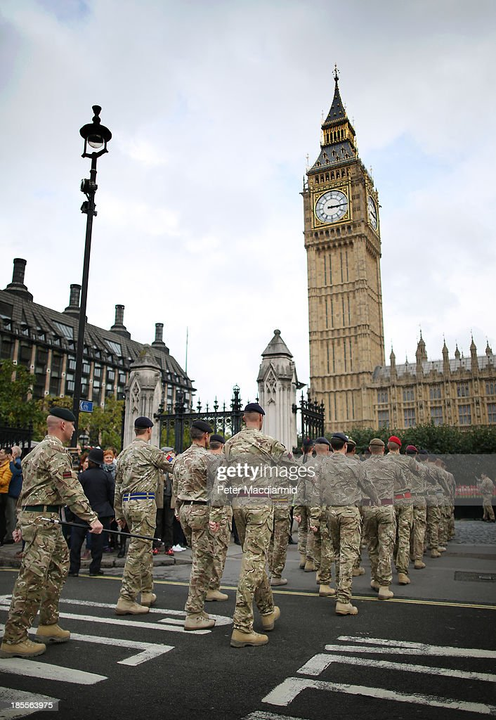 Soldiers of 1 Mechanized Brigade parade to Parliament on October 22, 2013 in London, England. 120 personnel who recently returned from Afghanistan's Helmand Province are attending a reception at the Houses of Parliament. The brigade recently completed a six-month summer tour under the command of Brigadier Rupert Jones, where they supported the Afghan National Security Forces in central Helmand.