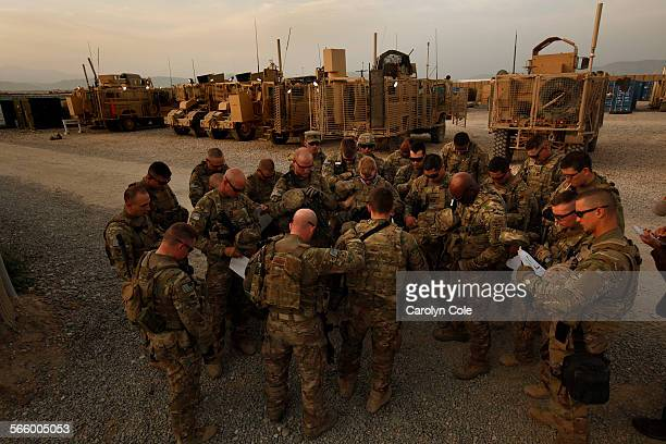 Soldiers of 1st Platoon 321st Engineering Company of Task Force Comet bow their heads in prayer before a route clearance mission in Kunduz Province...