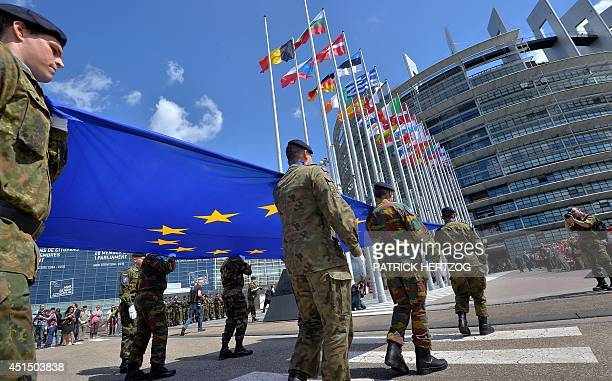 Soldiers of a Eurocorps detachment carry the European Union flag to mark the inaugural European Parliament session on June 30 in front of the...