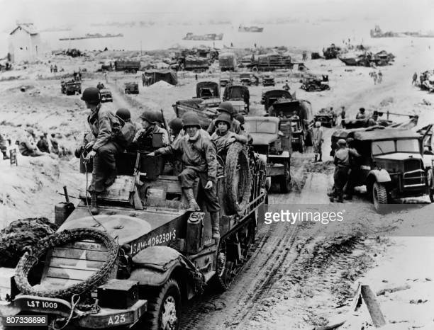 Soldiers of a French commando arrive on June 6 1944 after Allied forces stormed the Normandy beaches during DDay