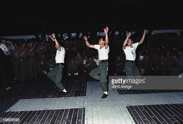 Soldiers of a Gurkha regiment dancing on board the Cunard liner QE2 which has been refitted as a troopship and is in the South Atlantic heading for...
