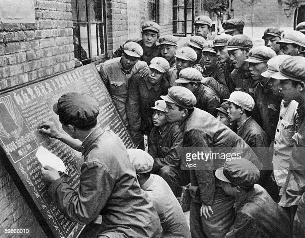 Soldiers of APL writing critics on blackboards against evil genius to defend Mao Zedong and communist party, june 1966 in Pekin