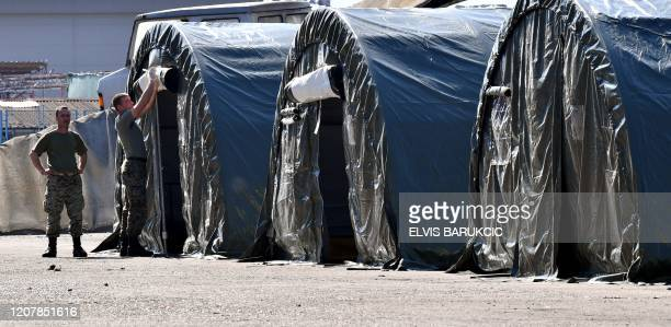 Soldiers of Bosnia and Herzegovina's armed forces set up tents in an improvised quarantine camp, near Bosnia-Croatia border crossing, in Northern...