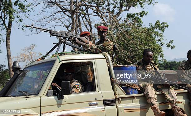 Soldiers of Central African Republic exrebel group Seleka patrol in a vehicle in a street of Bangui on December 1 2013 Paris will host on December 7...