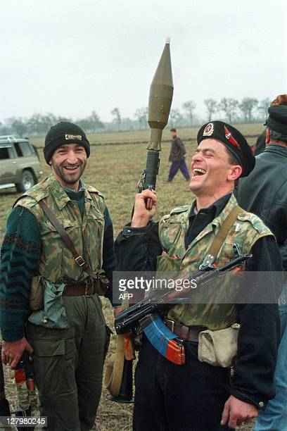 Soldiers of Chechen opposition based at Bratskoye share a laugh on November 22 1994 as they discuss their future battles with President Dzokhar...