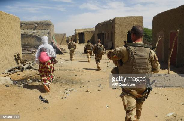 Soldiers of France's Barkhane mission patrol in InTillit on November 1 2017 in Mali as a joint antijihadist force linking countries in the Sahel...