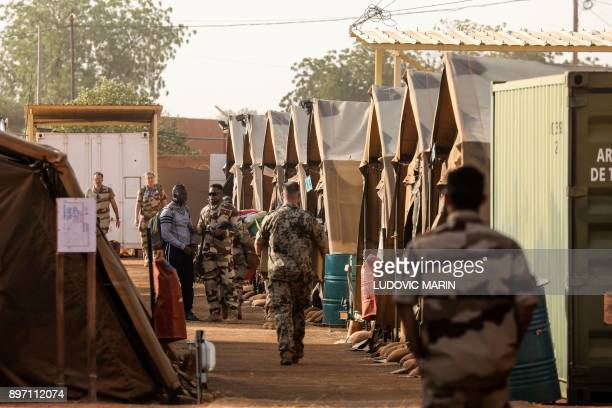 Soldiers of France's Barkhane mission walk in the military camp set up in a part of the airport base on December 22 in Niamey PHOTO / ludovic MARIN