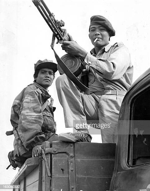 Soldiers of General Kong Le holding Russian made guns prepare to leave his Headquarters in Plaine des Jares Laos 1963