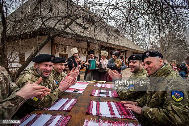 Soldiers of Georgia National Legion on the Maslenitsa festivities in Mamayeva Sloboda Kyiv Ukraine on March 13 2016