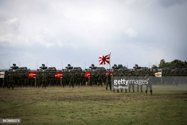 Soldiers of Japanese Ground Self-Defense Force , the brand-new Marinesnamed The Amphibious Rapid Deployment Brigade attend a ceremony in Camp Ainoura...