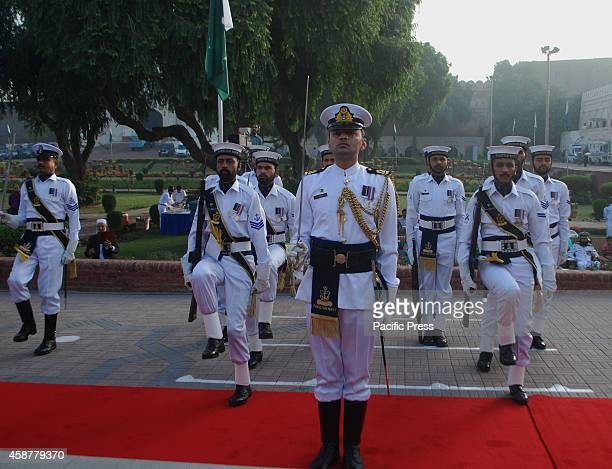 Soldiers of Pakistan Navy and Rangers present guard of honor in the commemoration ceremony of 137th birth anniversary of the National Poet and...