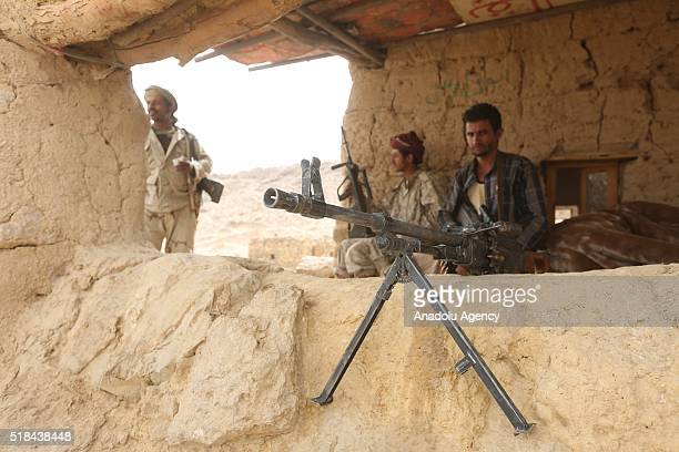 Soldiers of People's Resistance Forces loyal to President of Yemen Abd Rabbuh Mansur Hadi patrol after they recapture Baraqish ancient city from...