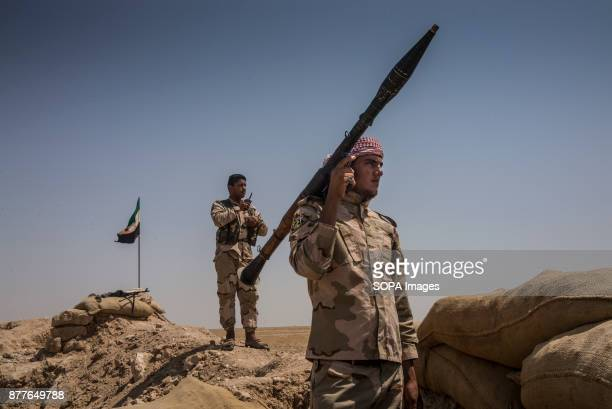 Soldiers of Quwat al Nukhba overlooks an ISIS village and prepare for a possible suicide car with Rocket Propelled grenades and PKM machine gun