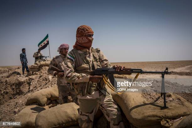 Soldiers of Quwat al Nukhba overlooks an ISIS village and prepare for a possible suicide car with Rocket Propelled grenades PKM machine gun and light...