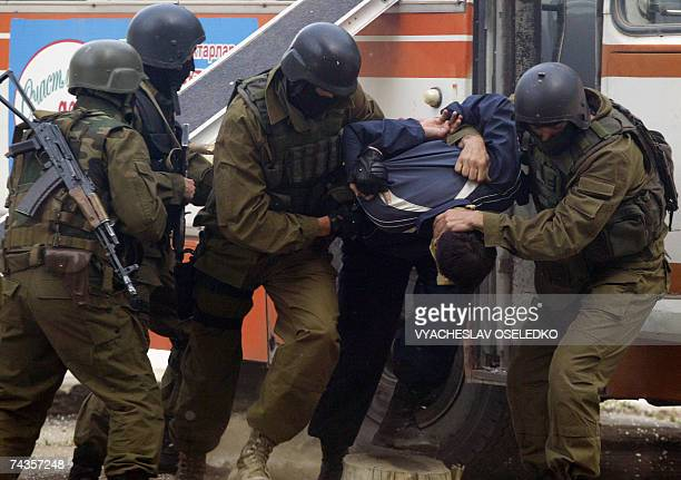Soldiers of Shanghai Cooperation Organization arrest a man during the Issyk Kul Antiterror 2007 military exercises some 200 km outside Bishkek, 30...