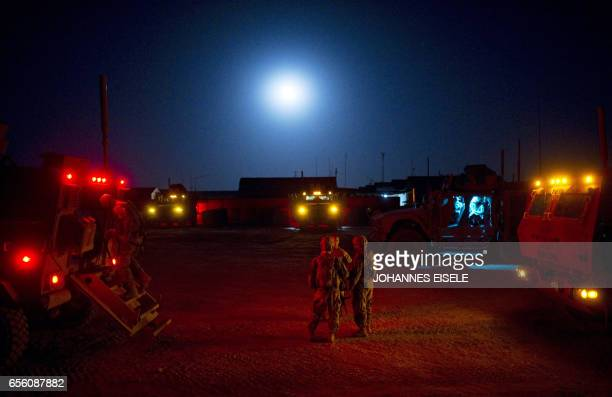 US soldiers of Task Force 366 Bravo Company 172nd Infantry Brigade prepare for a mission at Forward Operating Base Kuschamond early on September 11...