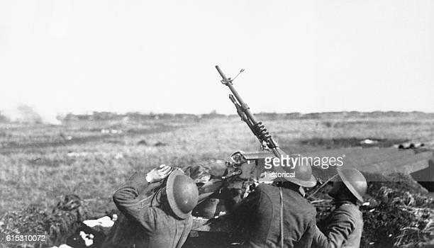 Soldiers of the 101st Field Artillery formerly the 1st Massachusetts FA New England Coast Artillery fire an antiaircraft machine gun on a German...