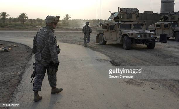 Soldiers of the 10th Mountain Division perform a mission in near Baghdad The three Humvee unit was to drive to a location near Camp Styker in order...