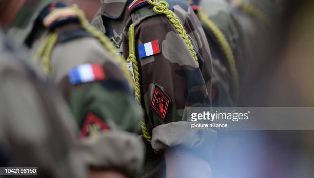 Soldiers of the 110th infantry regiment of the French Army stand together after a farewell parade in Donaueschingen Germany 23 June 2014 The French...