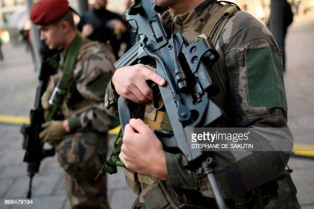 Soldiers of the 17/5 mobile police unit of Moulins carry FAMAS assault rifles during a visit by French Interior Minister Gerard Collomb at the Saint...