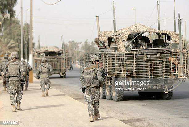 US soldiers of the 1st battalion 5th Infantry Regiment 1st Stryker Brigade Combat Team walk the streets following a ceremony of transfer from the US...