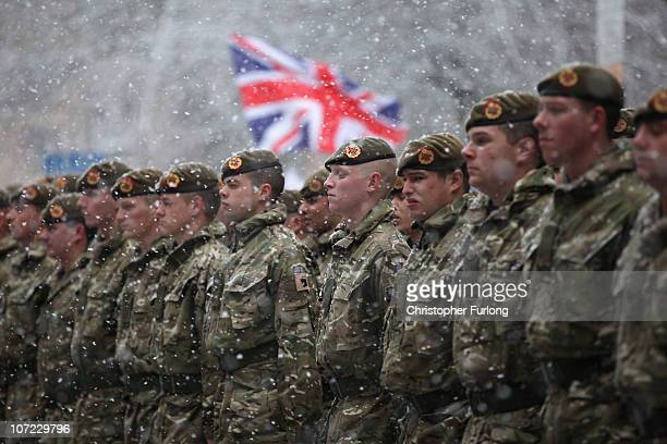 Soldiers of The 1st Battalion Duke of Lancaster's Regiment brave the snow as they march through the streets of Blackburn following a sixmonth tour of...