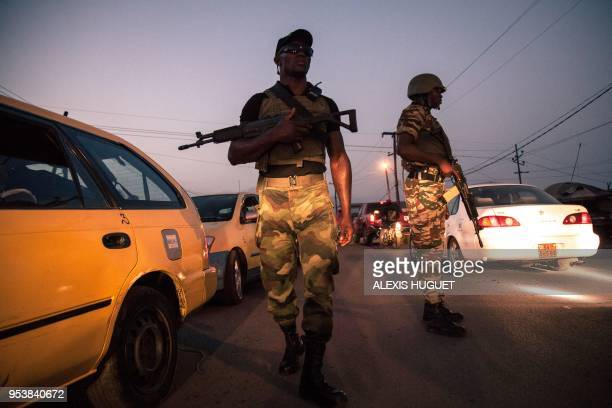 Soldiers of the 21st Motorized Infantry Brigade patrol in the streets of Buea SouthWest Region of Cameroon on April 26 2018 A social crisis that...