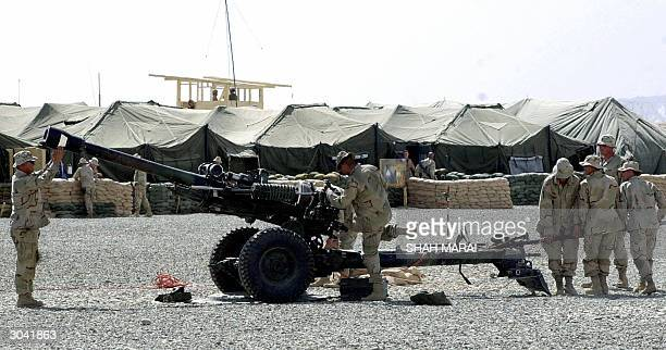 US soldiers of the 28th division clean an artillery gun during the ceremony for the launch of the USled Provincial Reconstruction Team in Ghazni 04...