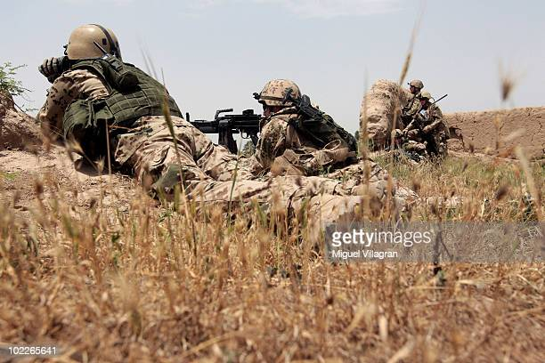 Soldiers of the 2nd Infantery Company observe a field on May 27, 2010 in Chahar Darreh, Afghanistan. Germany has more than 4,500 military forces in...