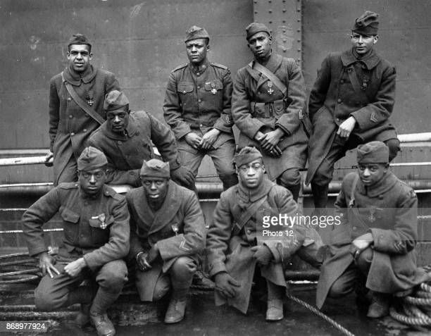 Soldiers of the 369th regiment of the American Army who won the Croix de Guerre for gallantry in action Left to right Front row Ed Williams Herbert...
