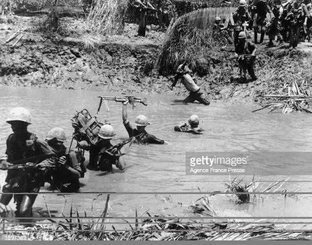Soldiers of the 3rd Brigade 9th Infantry Division US Army hold their weapons and supplies high as they cross a deep stream on a searchanddestroy...
