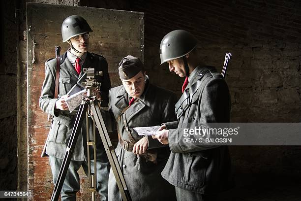 Soldiers of the 3rd Savoia Cavalry Regiment studying enemy locations on a map Italian army Russian Front 19421943 winter Second World War 20th...
