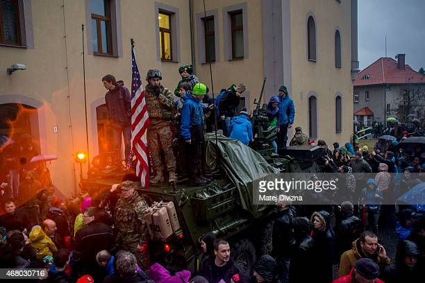 S soldiers of the 3rd Squadron 2nd Cavalry Regiment of the US Army with their vehicle stand among local residents on March 29 2015 in Liberec Czech...